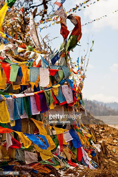 prayer flags covering sacred hill. - merten snijders stock pictures, royalty-free photos & images