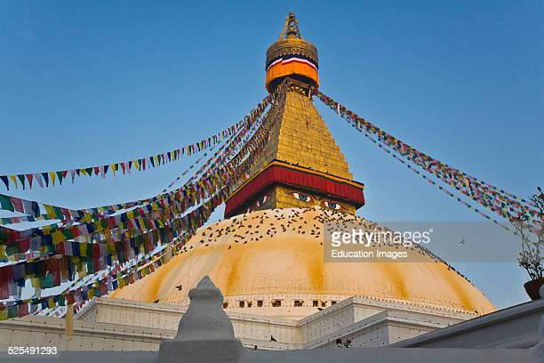 Prayer Flags Fly Over The Buddhist Relic Holder Bodhanath Stupa, One Of The Largest In The World, Kathamandu, Nepal.