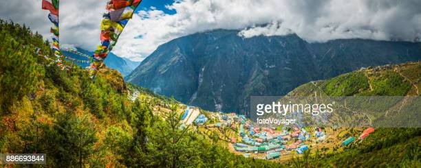 prayer flags flying over namche bazaar sherpa village himalayas nepal - khumbu stock pictures, royalty-free photos & images