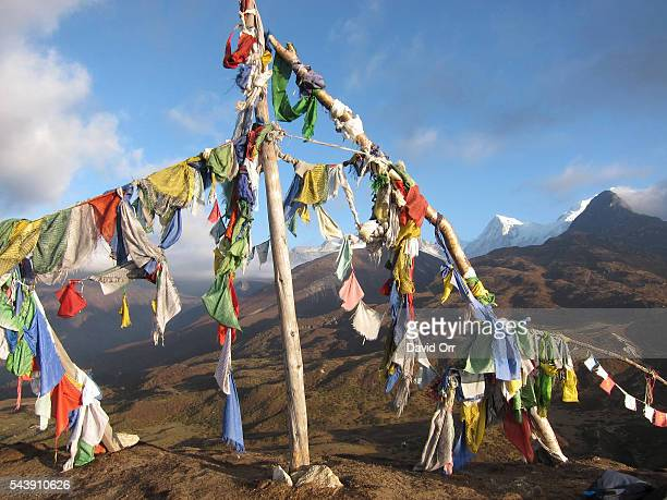 Prayer flags in India's Sikkim region with the Kanchenjunga range of the Himalayas in the background