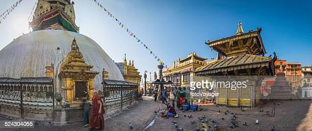 Prayer flags monks and shrines Swayambhunath Monkey Temple Kathmandu Nepal