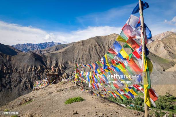 prayer flags on the top of mountain near lamayuru monastery in leh, ladakh, jammu and kashmir, india - kashmir stock photos and pictures
