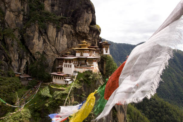 Prayer flags stretch across a valley  in Paro, Bhutan.