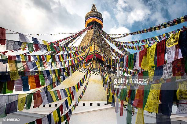 Prayer flags with the Boudhanath Stupa in Kathmandu, Nepal.