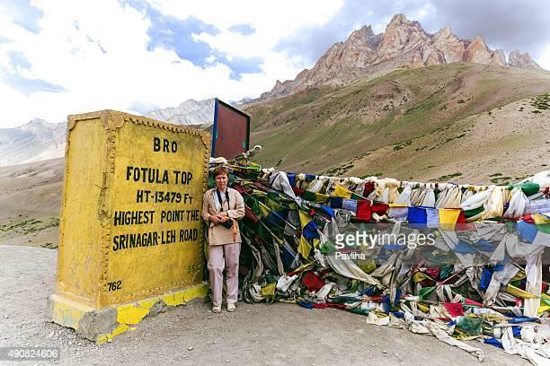 Prayer flags, woman, Fotu La Pass,Himalayas, Zaskar, Tibet,India