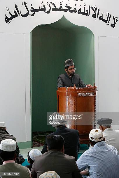 Prayer in an Ahmadiyya mosque Imam preaching SaintPrix France