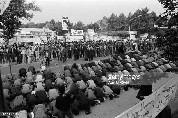 Prayer in front of the US embassy where 54 hostages are held by Islamist students on November 7 1979 in Tehran Iran