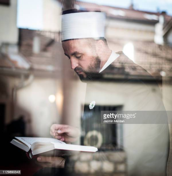Prayer inside mosque trough glass