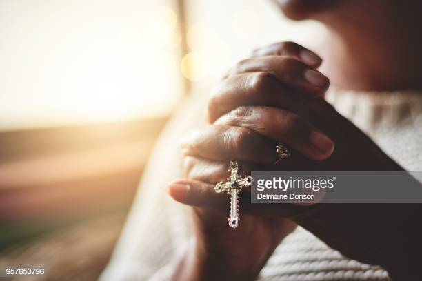 prayer is the pillar of strength - catholicism stock pictures, royalty-free photos & images