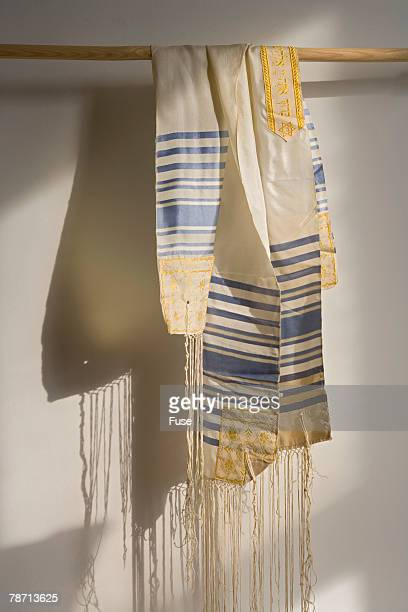 prayer shawl hanging from rod - jewish prayer shawl ストックフォトと画像