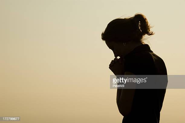 prayer silhouette - praying stock pictures, royalty-free photos & images