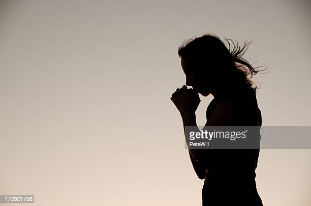 prayer silhouette - humility stock pictures, royalty-free photos & images