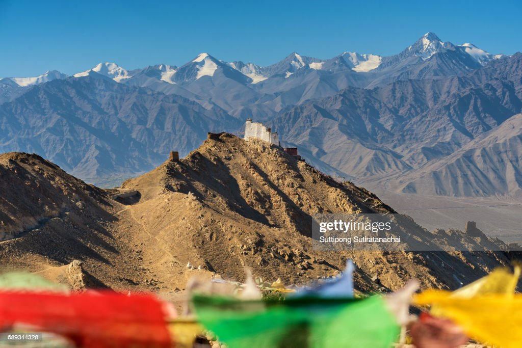 Prayer tibetan flags and the Namgyal Tsemo Monastery with mountain background in Leh, Ladakh : Stock Photo