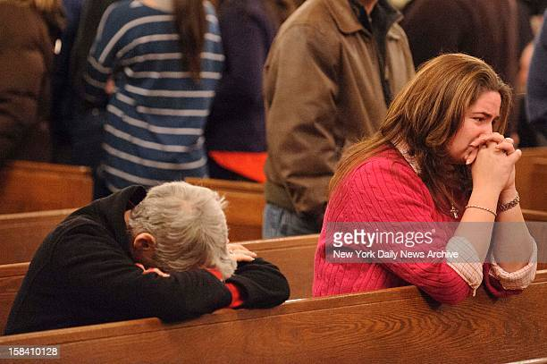 Prayer vigil at St Rose of Lima Roman Catholic Church after a mass murderer identified by authorities as Adam Lanza opened fire inside Sandy Hook...
