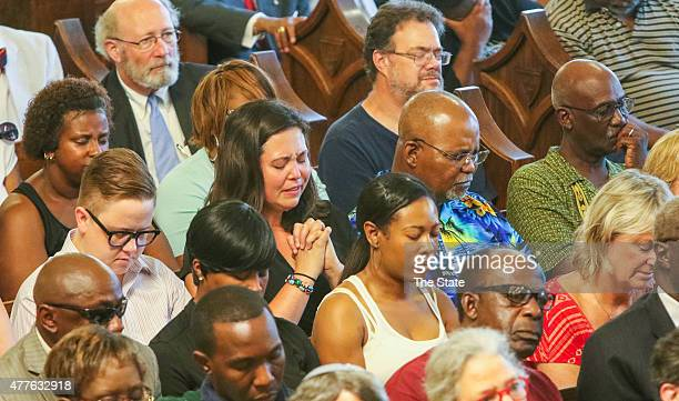 A prayer vigil is held at Morris Brown AME Church for the nine people who were killed by a gunman in Emanuel AME Church on June 18 2015 in Charleston...