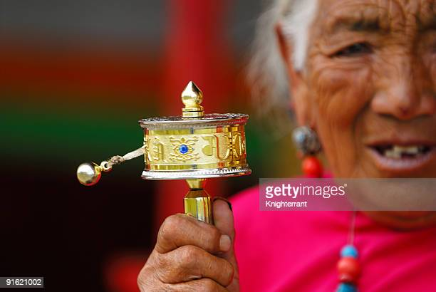 Prayer wheel and Senior Tibetan Face