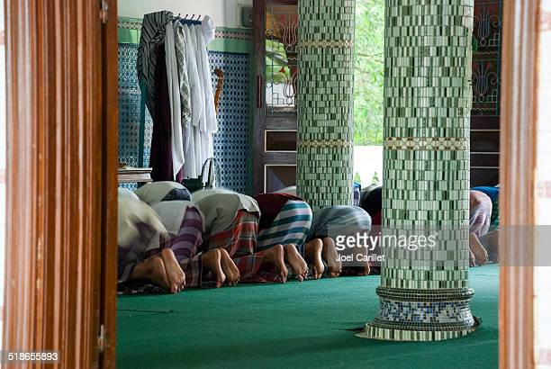 prayers at the mosque in chau doc, vietnam - foot worship stock pictures, royalty-free photos & images