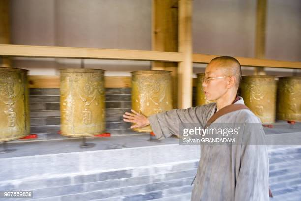 Prayers barrels Lama rite Tayuan temple Wutai shan one of the most ancient and renowned buddhist pilgrimage sites in China Shanxi Province Chine...