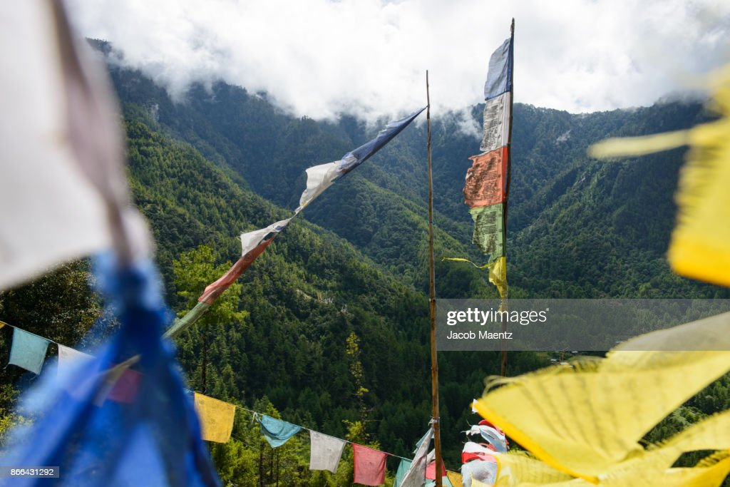 prayers flags on the side of a mountain paro bhutan ストックフォト