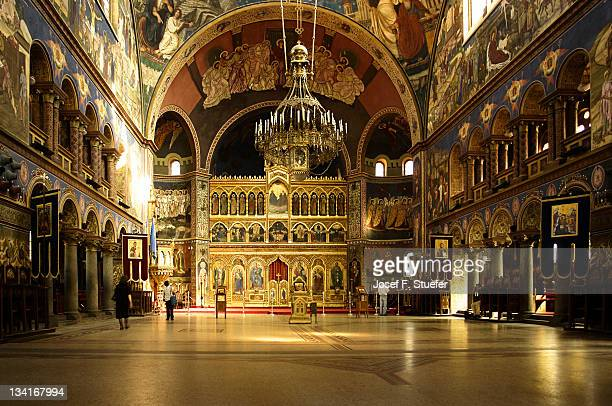 prayers in cathedral - sibiu stock photos and pictures