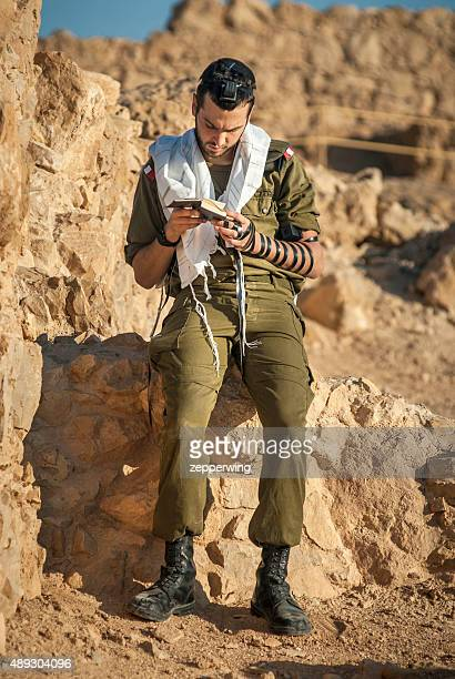prayers on masada - soldier praying stock photos and pictures