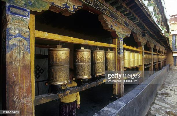 Prayers wheels Meru Sarpa monastery Tibet in Lhasa China