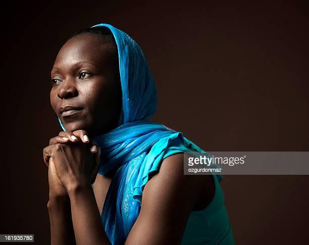 Praying African woman