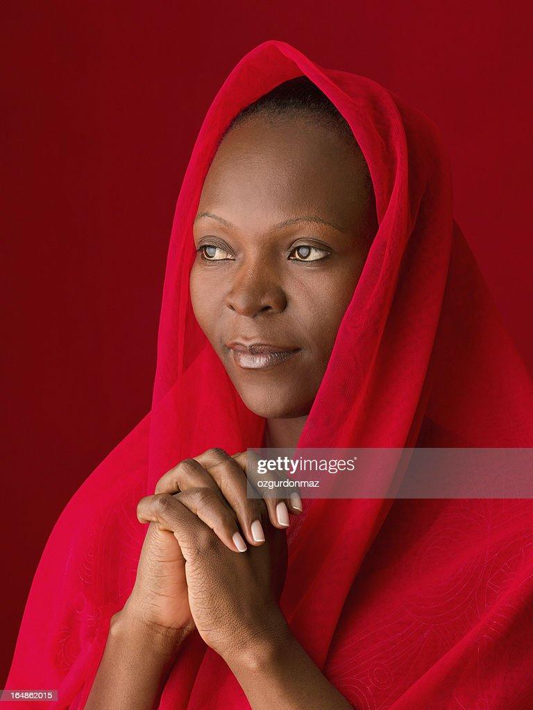 Praying African woman : Stock Photo