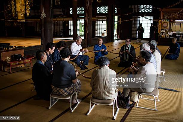 praying at a buddhist temple in kyoto - chanting stock pictures, royalty-free photos & images