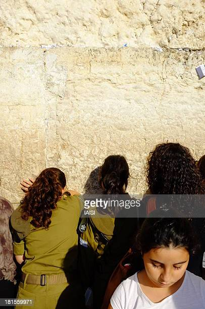 "Praying at The Western Wall aka Wailing Wall, in the old city of Jerusalem, Israel. Prières au Mur Occidental ou ""mur des lamentations"", dans la..."