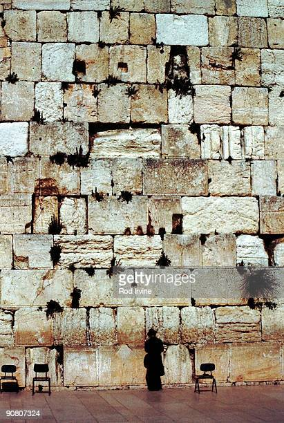 praying at the western wall - wailing wall stock pictures, royalty-free photos & images