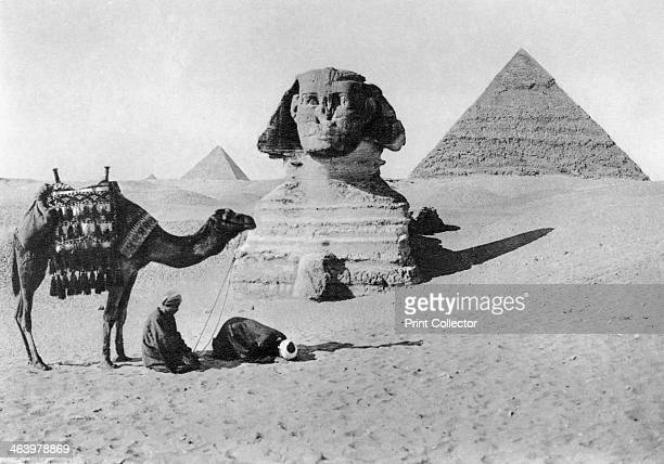 Praying before a sphinx Cairo Egypt c1920s Plate taken From In the Land of the Pharaohs published by Lehnert Landrock