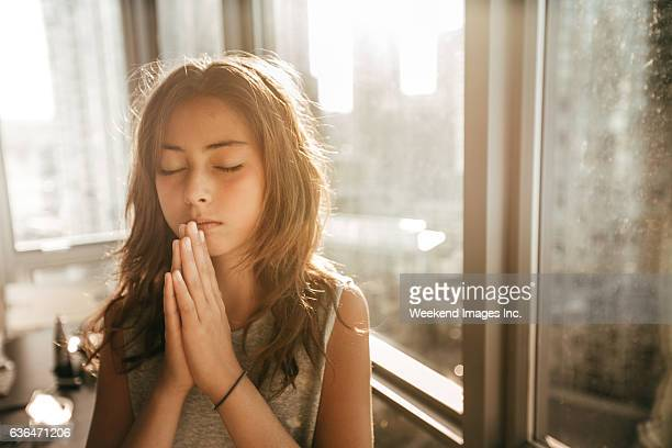 praying for my soul - praying stock pictures, royalty-free photos & images