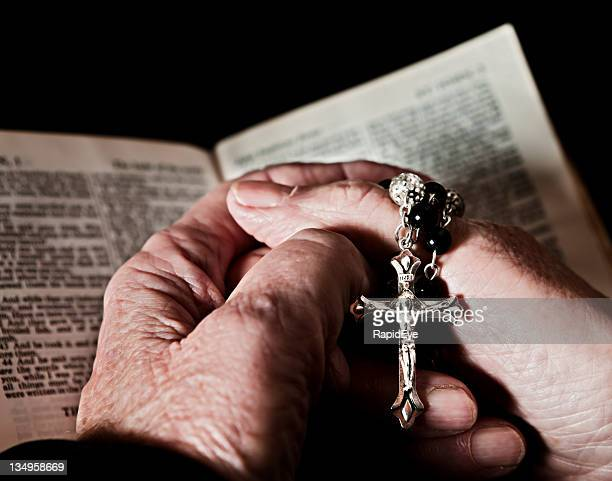 praying for salvation - rosary beads stock pictures, royalty-free photos & images