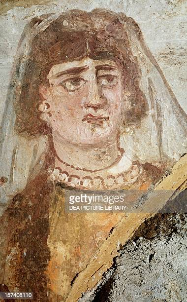 Praying fresco detail from the Catacombs of Jordanians Rome Italy 2nd century