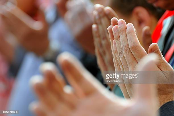praying hands in tahrir square - cairo, egypt - muslim praying stock pictures, royalty-free photos & images