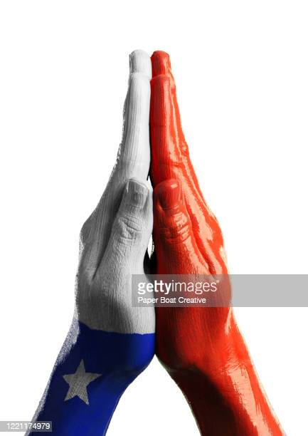 praying hands on white background with flag of chile - bandera chilena fotografías e imágenes de stock