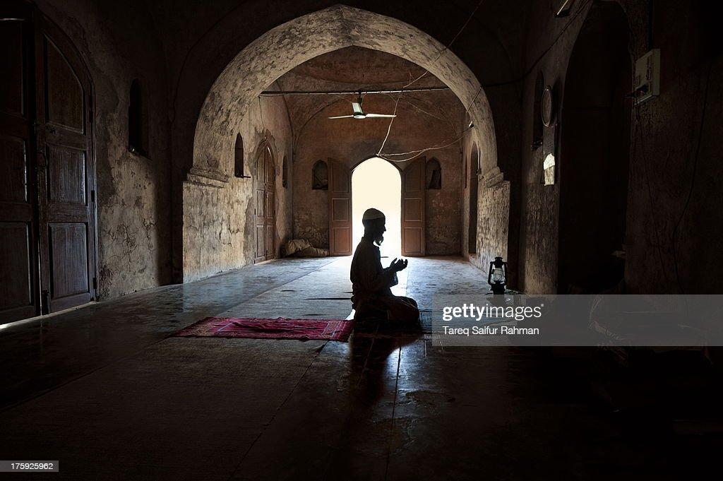 Praying Imam : Stock Photo