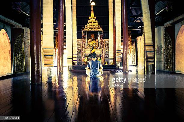Praying in a ancient temple