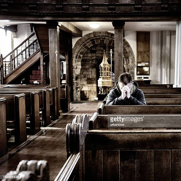 Praying in a church, UK