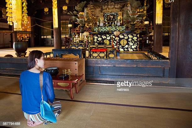 Praying inside a buddhist temple