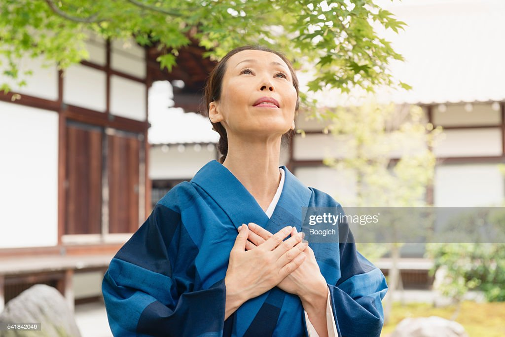 Praying Japanese Woman Looking Up with Joy Temple Kyoto Japan : Stock Photo
