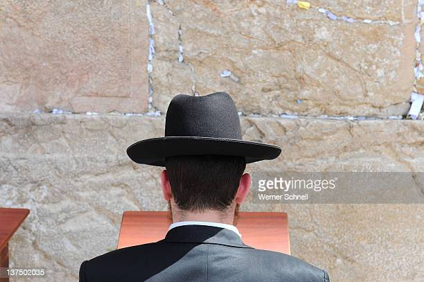 praying jew at western wall, jerusalem - jewish man stock photos and pictures