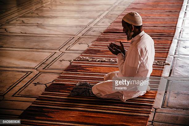 praying man in jama masjid mosque - praying stock pictures, royalty-free photos & images
