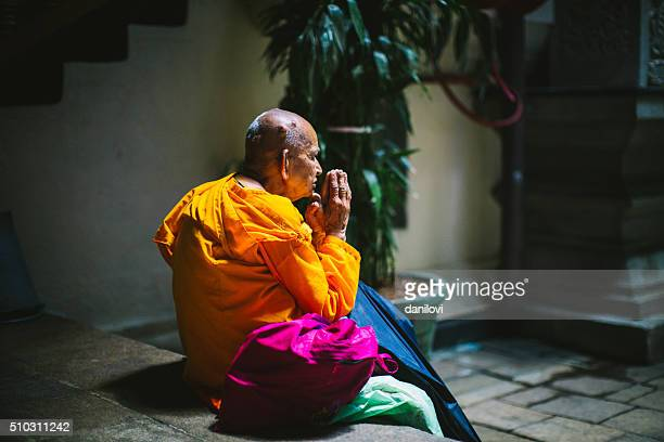praying monk in the temple of the tooth, sri lanka - dalada maligawa stock photos and pictures