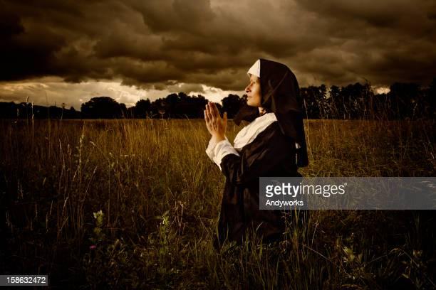 Praying Nun In The Evening