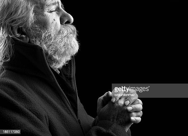 Praying old man