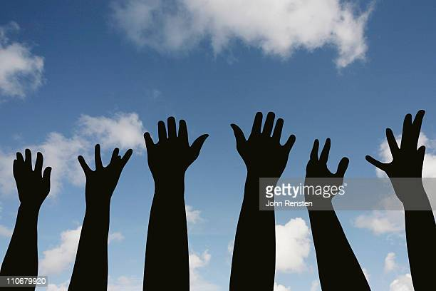 praying or protesting? hands in the air - protestor stock pictures, royalty-free photos & images