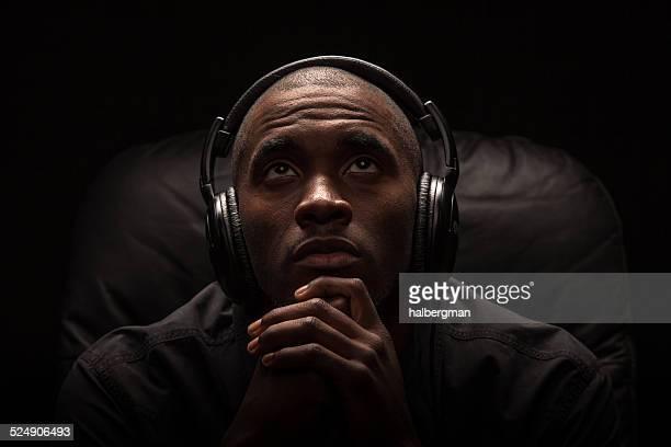 praying to music - black people praying stock pictures, royalty-free photos & images