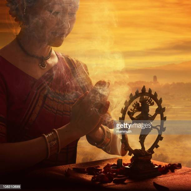 praying to shiva - incense stock photos and pictures